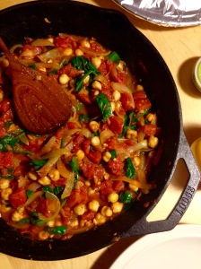 Spinach and chickpea Indian curry in cast iron skillet
