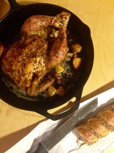 Feta brined roasted chicken in a cast iron skillet with Arcade Bakery baguette