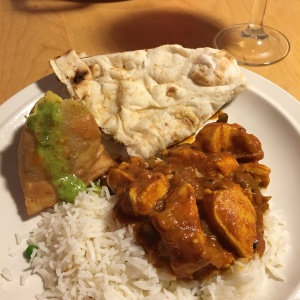 Meera Sodha recipe for chicken curry served with naan, samosa, and basmati rice