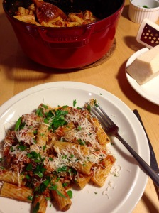 Ragu with rigatoni pasta, Italian sausage, parmesan cheese, and parsley