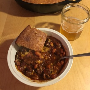 Texas chili with stew beef, pinto beans, cornbread and beer