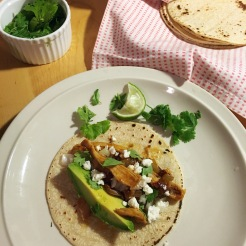 Chicken tacos with chiles in adobo, feta, cilantro, avocado and lime