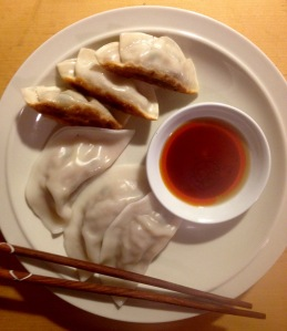 Homemade fried dumplings and boiled dumplings with dipping sauce