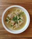 Wonton soup with scallions and sesame oil