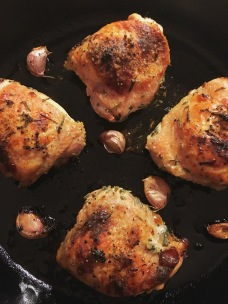 Nigella Lawon recipe for buttermilk roast chicken in cast iron skillet with garlic