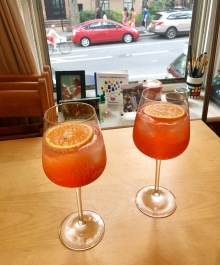 Aperol Spritz with orange slices on kitchen table