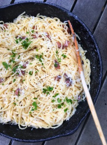 Spaghetti carbonara pasta with guanciale in cast iron skillet